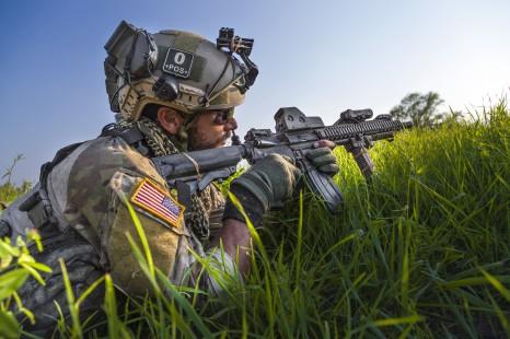 soldier aims gun