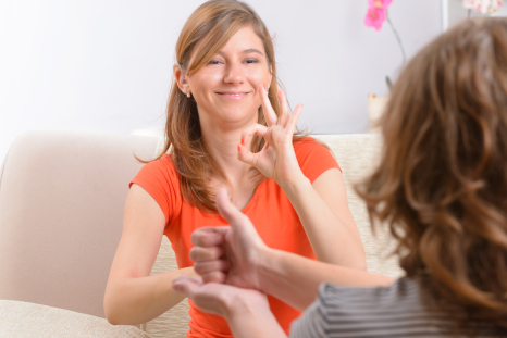 Young woman learning sign language