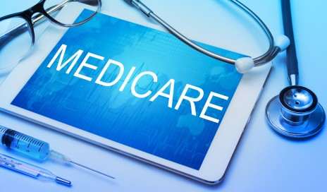 http://www.dreamstime.com/stock-photo-medicare-word-tablet-screen-medical-equipment-background-image92272950