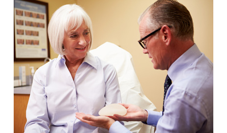 http://www.dreamstime.com/stock-image-woman-discussing-breast-augmentation-plastic-surgeon-clinic-holding-silicon-image40126321