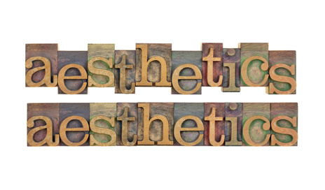 http://www.dreamstime.com/stock-image-aesthetics-word-vintage-wood-letterpress-type-stained-color-ink-isolated-white-two-layouts-image41162771