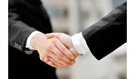 http://www.dreamstime.com/royalty-free-stock-photography-businessmen-shaking-hands-business-deal-partnership-concept-two-image42827927