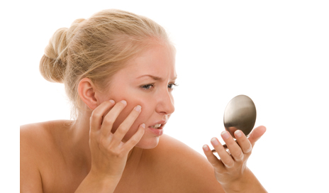 http://www.dreamstime.com/stock-photography-woman-finding-acne-image16406082
