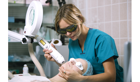 http://www.dreamstime.com/stock-photos-woman-undergoing-laser-skin-treatment-photorejuvenation-her-face-beauty-salon-clinic-image35781733