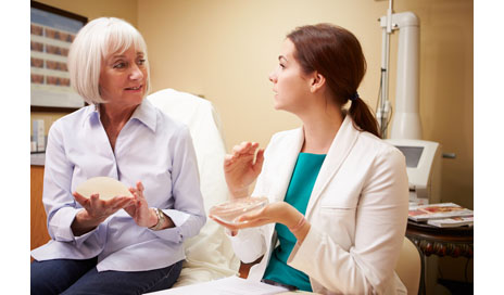 http://www.dreamstime.com/stock-photo-woman-discussing-breast-augmentation-plastic-surgeon-clinic-looking-each-other-image40126160