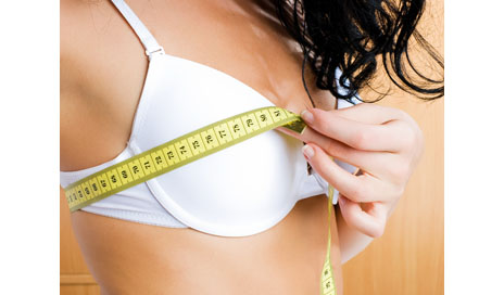 http://www.dreamstime.com/stock-photo-young-woman-measuring-her-breast-home-image7233640