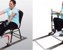 Sitroll user demonstrates exercise by grasping both side handles and holding firmly. Both feet are placed on lower resistance bands and user then rolls forwards and backwards at a comfortable speed, by pulling and pushing with the arms and legs.