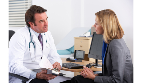 http://www.dreamstime.com/stock-photos-american-doctor-talking-to-businesswoman-patient-image24161333
