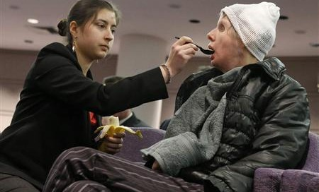 Briana Nash feeds her mother, Charla, who lost her hands in a chimpanzee attack