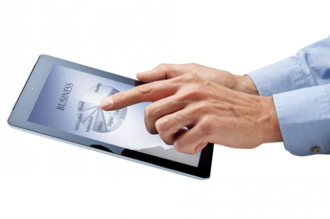 http://www.dreamstime.com/royalty-free-stock-photography-business-computer-ipad-tablet-hands-image27434137