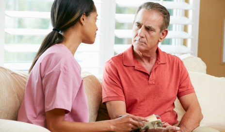 http://www.dreamstime.com/stock-photography-nurse-discussing-records-senior-male-patient-image29054352