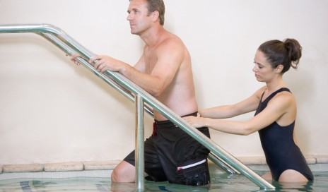http://www.dreamstime.com/stock-photo-instructor-patient-undergoing-water-therapy-image9002970