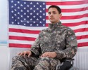 http://www.dreamstime.com/stock-images-patriotic-soldier-sitting-wheel-chair-against-american-flag-cropped-image-image40192024