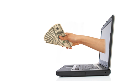 http://www.dreamstime.com/royalty-free-stock-image-money-laptop-image2417286