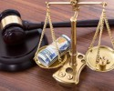 http://www.dreamstime.com/royalty-free-stock-image-gavel-scales-money-desk-judge-wooden-image46358826