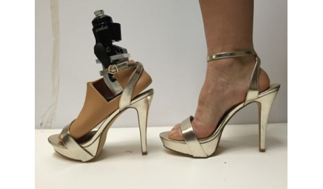 "Pictured here is a side-by-side comparison of the ""Prominence"" prosthetic foot (left) and a natural foot in stiletto heels. (Photo courtesy of Johns Hopkins University senior design team)"