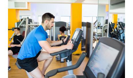 http://www.dreamstime.com/royalty-free-stock-image-fit-man-using-exercise-bike-men-gym-image60892406