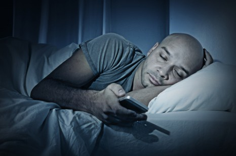 http://www.dreamstime.com/royalty-free-stock-photography-young-cell-phone-addict-man-sleeping-night-bed-using-smartphone-chatting-flirting-sending-text-message-image45794287